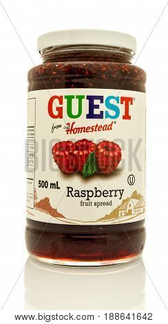 Winneconne WI - 16 May 2017: A jar of Guest from old homestead raspberry fruit spread on an isolated background.