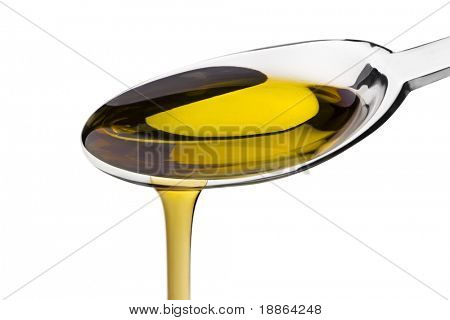 Olive oil poured from a spoon isolated on white with clipping path