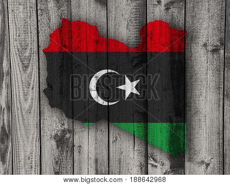 Map And Flag Of Libya On Weathered Wood