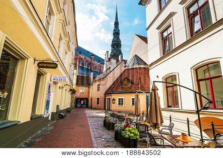 Street Cafe And Steeple Of Saint Peter Church Riga