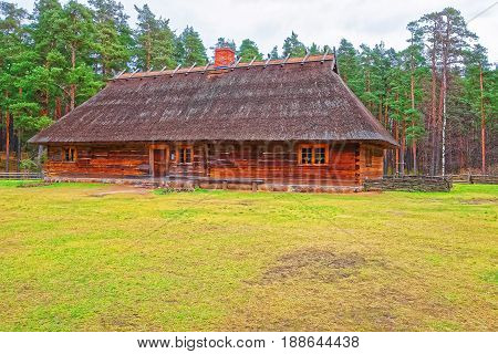 Old Traditional Wooden House In Ethnographic Village In Riga