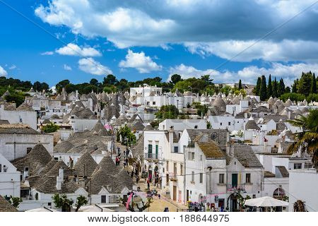 ALBEROBELLO, ITALY - MAY 7 2017: An overview of the Alberobello - a small town in southern Italy famous for its unique trullo/trulli buildings which have been designated as a UNESCO World Heritage.