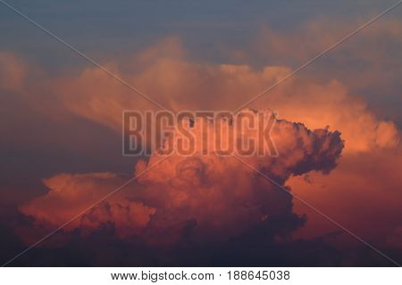 Clouds reflecting intense colour of May sunrise