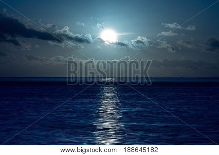 Full moon over on the sea at night.