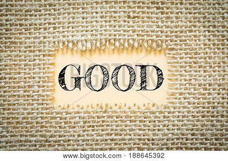 Text GOOD on paper has Cotton yarn background you can apply to your product.