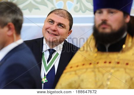 Orel Russia - July 28 2016: Russia baptism anniversary Divine Liturgy. Vadim Potomsky Orel city governor smiling in church selective focus