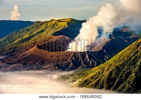 Mount Bromo volcano (Gunung Bromo) during sunrise from viewpoint on Mount Penanjakan in Bromo Tengger Semeru National Park East Java Indonesia.