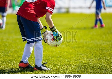 Youth Soccer Goalkeeper Catch. Football Soccer Game. Kids Playing Soccer Match on the Pitch