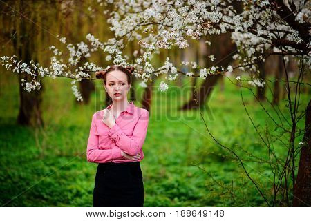 Sensuality. Happy Beautiful Young Woman Relaxing In Blossom Park