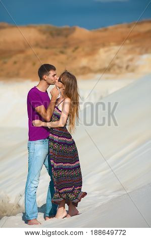 lovers on romantic travel honeymoon vacation summer holidays romance. Young happy couple on the beach, caucasian woman and man embracing and kissing outdoors