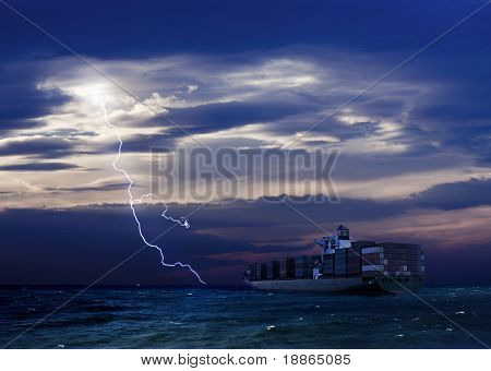 Cargo Ship and Lightning over sea with dark clouds