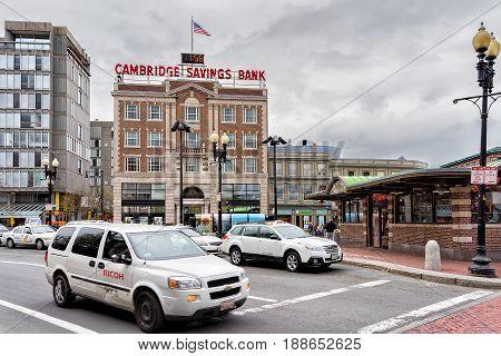 Cambridge USA - April 29 2015: Road with car traffic at Cambridge Massachusetts USA. Cambridge Savings Bank on the background
