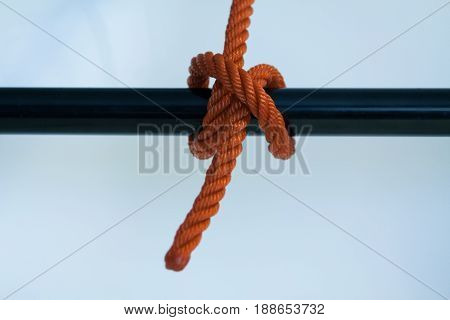 Rolling hitch knotted on a white background.
