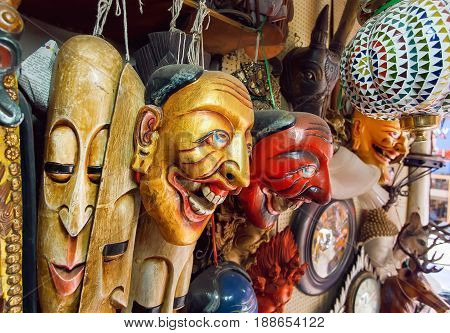 Store with vintage theatrical masks art objects and antiques in second-hand department.