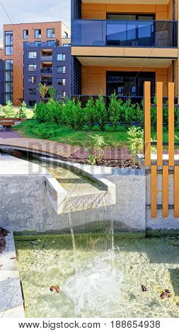 Fountain At Modern Complex Of Residential Building