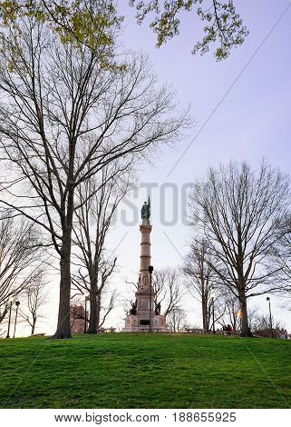 Soldiers and Sailors Monument at Boston Common public park in Boston MA United States. In the evening. People on the background