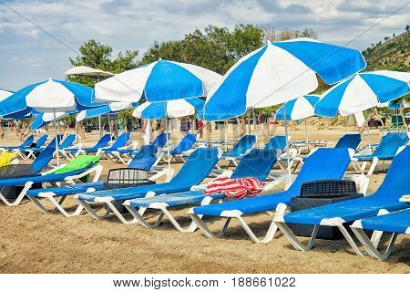 Sunbeds With Shelters On Beach In Omis