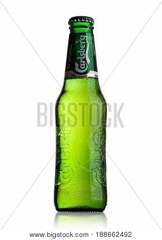 London, Uk - May 29, 2017: Bottle Of Carlsberg Beer On White. Danish Brewing Company Founded In 1847