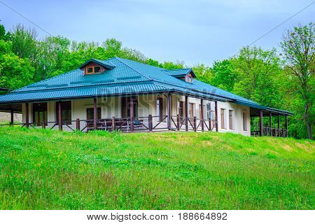 Cottage on a green hill a magical place to relax under the blue sky around the beautiful nature all green tourist season