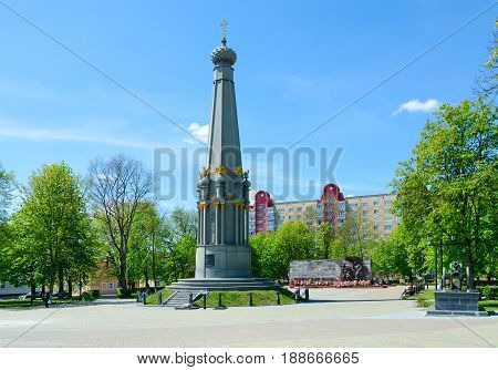 POLOTSK BELARUS - MAY 19 2017: Unknown people are walking on Liberty Square near monument to heroes of Patriotic War of 1812 Polotsk Belarus