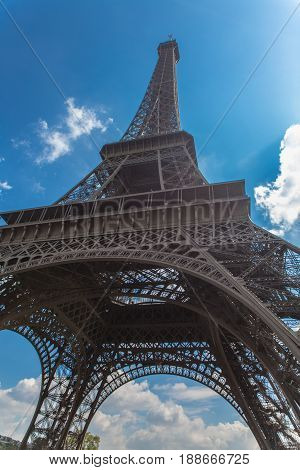 eifel tower bottom view with cloud sky on background