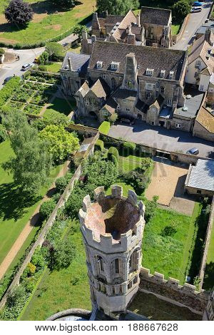 ELY, UK - MAY 26, 2017: Aerial view of the Bishop of Ely with a turret in the foreground - picture taken from the top of the West Tower of the Cathedral