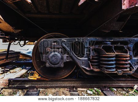 Close-up Steel diesel railcar train bogie wheels on the tracks.