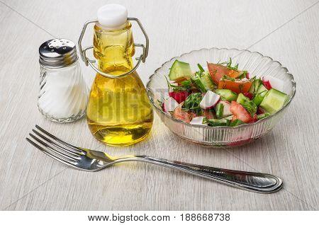 Vegetable Salad, Bottle Of Oil, Salt And Fork On Table