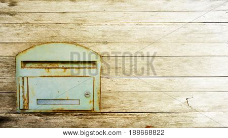 the postbox on the wood background .