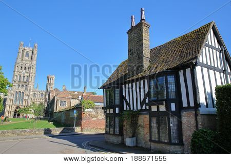 View of a timbered framed and medieval house in Ely (UK) with the West part of the Cathedral in the background