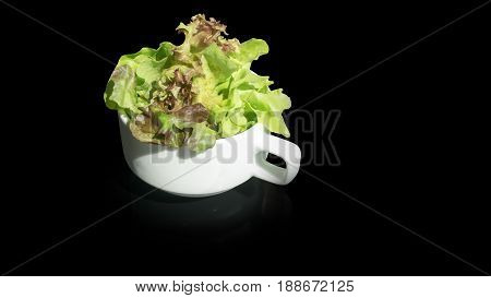 Salad in a cup on black table background