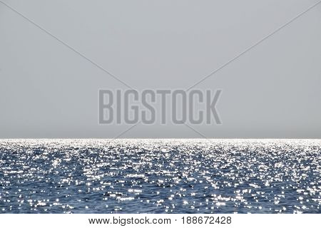 Sea Line Of The Horizon. Sea And Sky. The Waves And Glare Of The Sun Are Reflected From The Waves Of