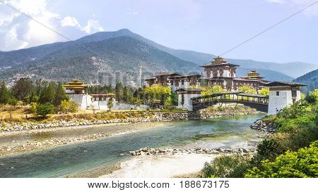 The Punakha Dzong Monastery and bridge across the river in Bhutan Asia one of the largest monestary in Asia with the landscape and mountains background PunakhaBhutan