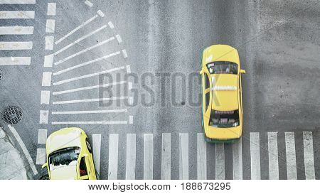 blur city car are passing pedestrian crossing on traffric road (Aerial photo top view)
