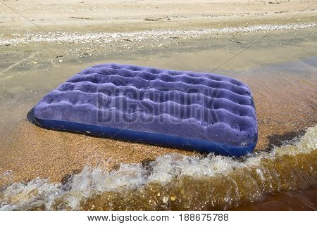 Blue Inflatable Mattress Swimming In The Pond