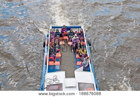 SAINT - PETERSBURG, RUSSIA - MAY 30, 2017: Top view of the people in excursion boat. The boat sails under The Troitskiy (Trinity) Bridge on the Neva River