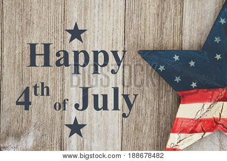 Happy Independence Day Greeting USA patriotic old star on a weathered wood background with text Happy 4th of July Day