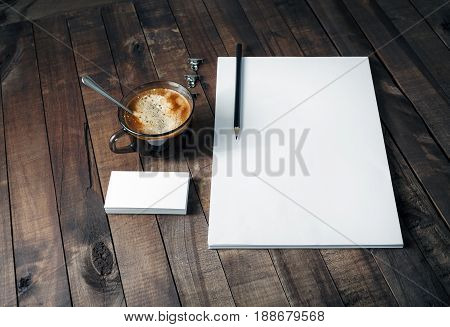 Blank branding template on vintage wooden table background. Letterhead business cards coffee cup and pencil. Photo of blank stationery. Responsive design template. Mock-up for placing your design.
