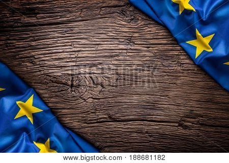 Flag of Europe union on old wooden background. EU flag old oak background.Horizontal.
