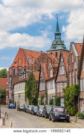 LUNEBURG, GERMANY - MAY 21, 2017: Street leading to the Michaelis church in Luneburg, Germany