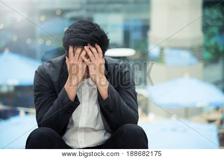 Frustrated Asian Businessman failing about his business. Stress tired concept.