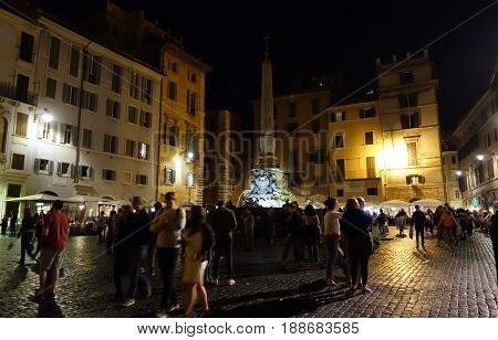 ROME ITALY - MAY 20 2017: People under the Fontana del Pantheon placed in Piazza della Rotonda during the nationwide Notte dei Musei