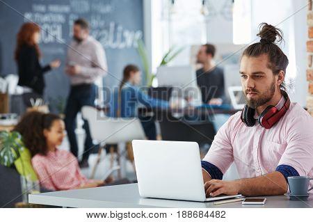 Confident Man Working On Startup