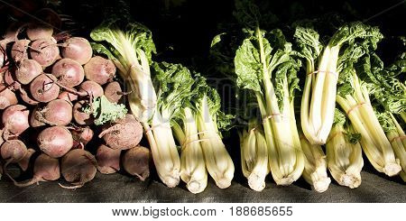 A table display of fresh vegitables at a farmer's market includes Turnip - (Brassica rapa subsp. rapa) Beetroot - (Beta vulgaris) and Spinach (Spinacia oleracea). Market located at Gosford New South Wales Australia.