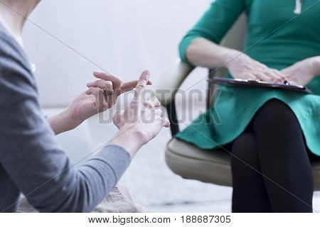 Close-up of woman's hands explaining the problems to psychotherapist