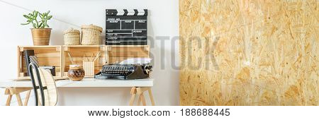 Creative home workspace with osb wall desk and chair panorama