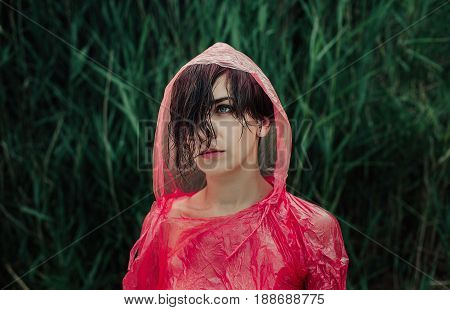 The Portrait Of Girl In Red Raincoat Under The Rain.