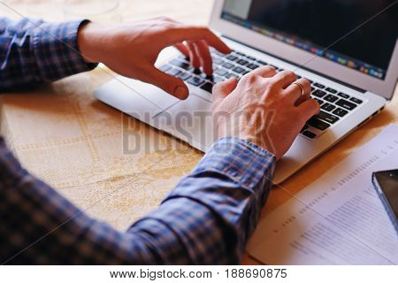 Closeup Of Businessman Is Keyboarding On Portable Net-book