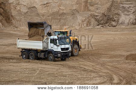 Truck And Loader On An Outcrop Site