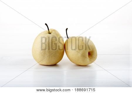 Chinese white pears or ya pears on white wooden table